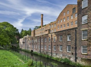 Quarry Bank Mill, the eighteenth century cotton mill established by Samuel Greg which was powered by water drawn from the River Bollin in which valley the mill and Styal Estate prospered, Wilmslow, Cheshire.